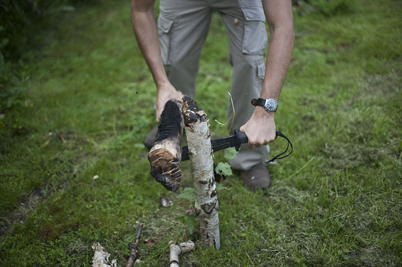 making dry tinder from wet log