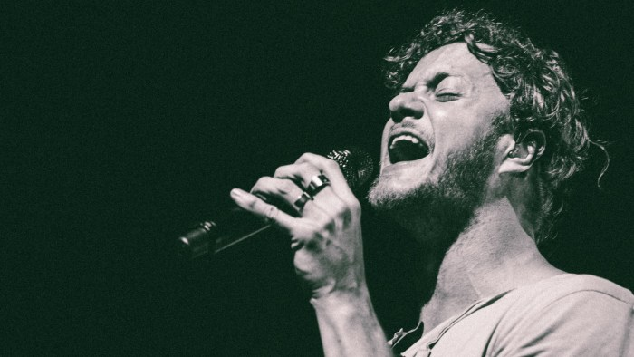 "Dan Reynolds of Imagine Dragons performs at Bridgestone Arena in Nashville, Tenn. on Wednesday, June 8, 2015, The performance was part of the band's ""Smoke + Mirrors"" tour. (MTSU Sidelines / Andre Rowlett)"