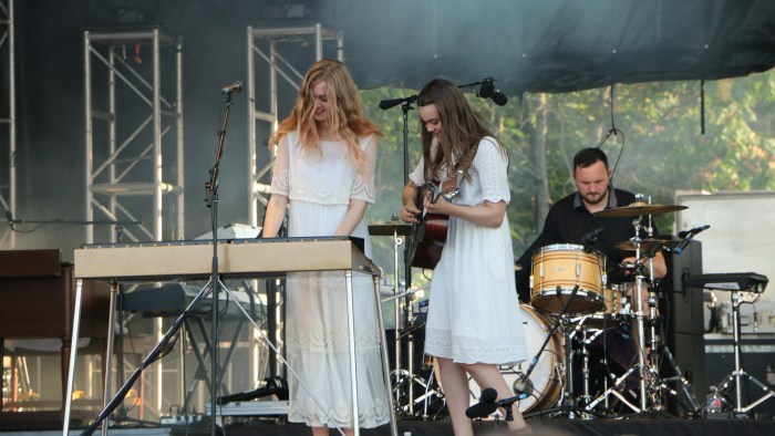 Johanna Söderberg, left, Klara Söderberg, center, and Scott Simpson, right, of First Aid Kit perform at the Sloss Music & Arts Festival in Birmingham, Ala., on Saturday, July 18, 2015. (MTSU Sidelines / John Connor Coulston)