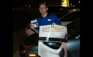 Murfreesboro resident Griffin Rollins poses with his Battlefront game and poster. (MTSU Sidelines/ Tanner Dedmon)