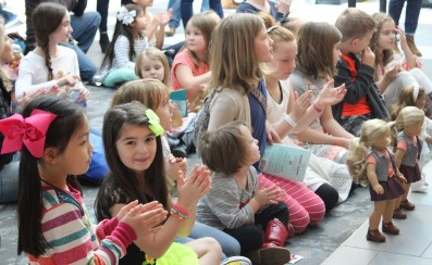 A crowd of children gathers to watch young local performers. (Sidelines / Tayhlor Stephenson)