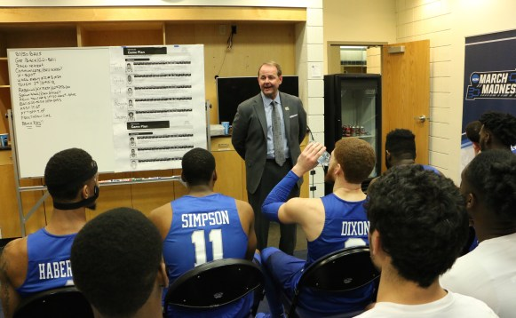 MTSU head coach giving a speech in the locker room to his team following in an NCAA Tournament first-round game against Minnesota in Milwaukee, WI on March 16, 2017. (MTSU Sidelines/Tyler Lamb)