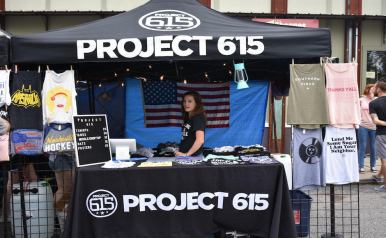 The Project 615 booth sells merchandise at 6-1-5 Day. (Genesis Rodriguez / Sidelines)
