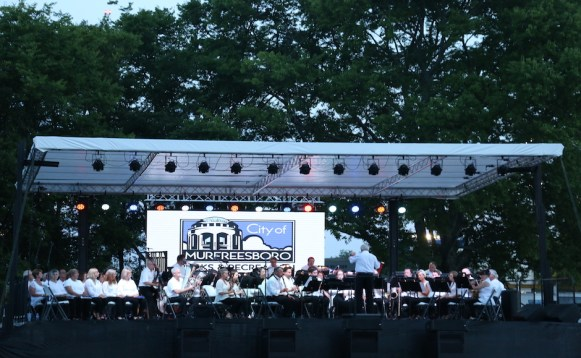 "Conducted by Dr. Laurence Harvin, the Murfreesboro City Orchestra Choir performs at the City of Murfreesboro's ""Celebration Under the Stars"" at McKnight Park in Murfreesboro, Tenn. on July 4, 2017. (Connor Burnard / MTSU Sidelines)"