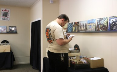 Thomas Harding browses through Waxface Records' selection of vinyl during their grand opening celebration on July 1, 2017. (Krystal Loritts / MTSU Sidelines)