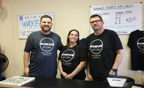 Employees Ryan Maous, Lacy Button and Reid Conner pose behind the register at Waxface Records on July 1, 2017. (Krystal Loritts / MTSU Sidelines)