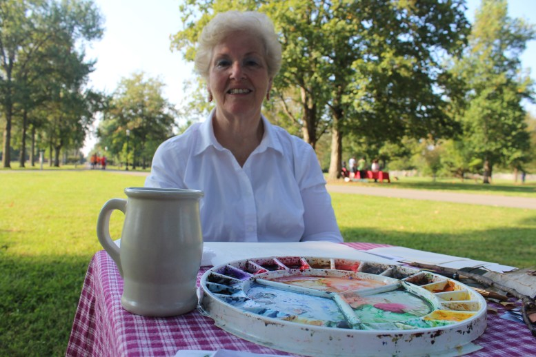 Artist Phyllis Razo sets up an oil painting station to show children one of the first forms of painting at Oaklands Mansion's Autumn in the Oaks Educational Field Day in Murfreesboro, Tenn. on September 21, 2017. (Shade Narramore / MTSU Sidelines)