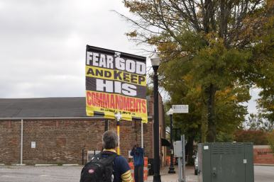 Preachers wielding signs march into the Square in Murfreesboro, Tenn. on Oct. 28, 2017. (Andrew Wigdor / MTSU Sidelines)