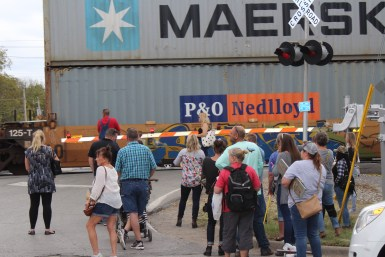 Guests of the Bell Buckle Craft Fair wait for a train to pass in Bell Buckle, Tenn. on Oct. 22. (Tayhlor Stephenson / MTSU Sidelines)