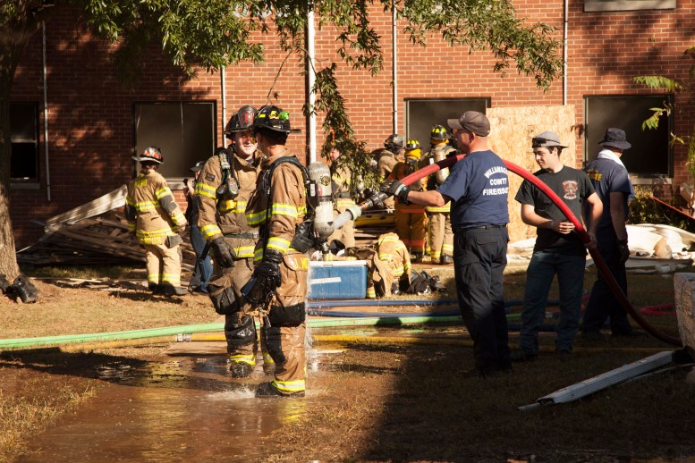 Firefighters get sprayed down after live fire exercise on Oct. 17, 2017. (Sabrina Tyson / MTSU Sidelines)