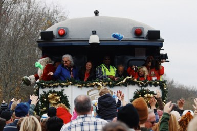 Ricky Skaggs, Santa and Santa Train workers toss gifts from the train in St. Paul, Virginia, on Nov. 18, 2017. (Anthony Merriweather / MTSU Sidelines)