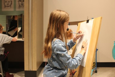 Kylie Fish, 9, enjoys drawing in the Martin ArtQuest at the Frist Family Festival Day in Nashville, Tenn. on Sunday, Nov. 12, 2017. (Shade Narramore / MTSU Sidelines)