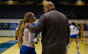 Coach Chuck Crawford shares a word with lone senior Sloan Sullivan after she exits the game against Florida International on Thursday, Nov. 9 in Murfreesboro, Tenn. (Andrew Brown / MTSU Sidelines)