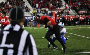 Redshirt junior Darryl Randolph tackles WKU quarterback Mike White against Western Kentucky in Bowling Green, Ky. on Nov. 17, 2017. (Devin P. Grimes / MTSU Sidelines)