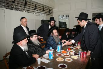 Tenker Rav with the Kaliver Rebbe at a MTV Event