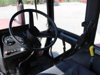 В кабине трактора Беларус