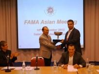 Mr Nasiri - Iran Muaythai presents a cup to IFMA President Dr Tapsuwan