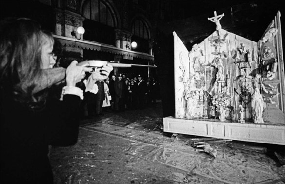 Film of Saint Phalle shooting an altar; pic: Grand Palais/RMN/Ina