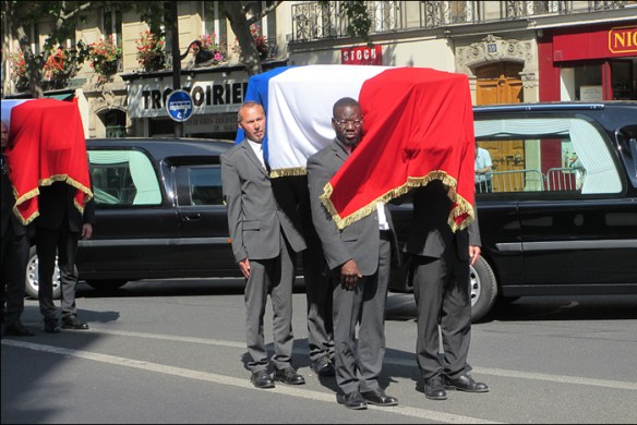 Coffins being carried past the crowds; pic; Cynthia Rose