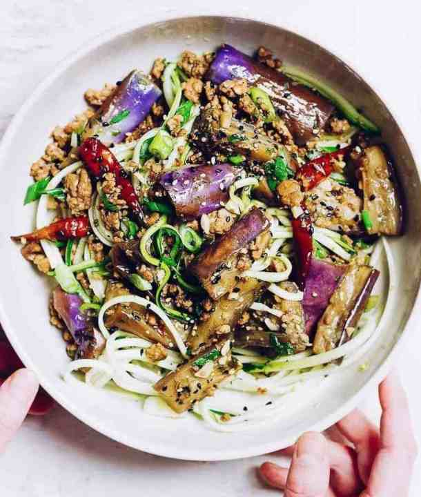 Paleo Chinese Eggplant in Garlic Sauce with buttery and melt-in-your-mouth eggplants, braised in a garlic sauce. This eggplant recipe is vinegary, naturally sweet, and savory, plus it's Paleo, Whole30, and gluten-free.