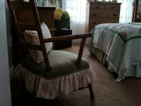 This little chair was my husbands when he was little, for years we didn't sit in it because the seat was not sturdy. Just recently I had my friend Barbara make the skirt and pillow she also reinforced the seat -