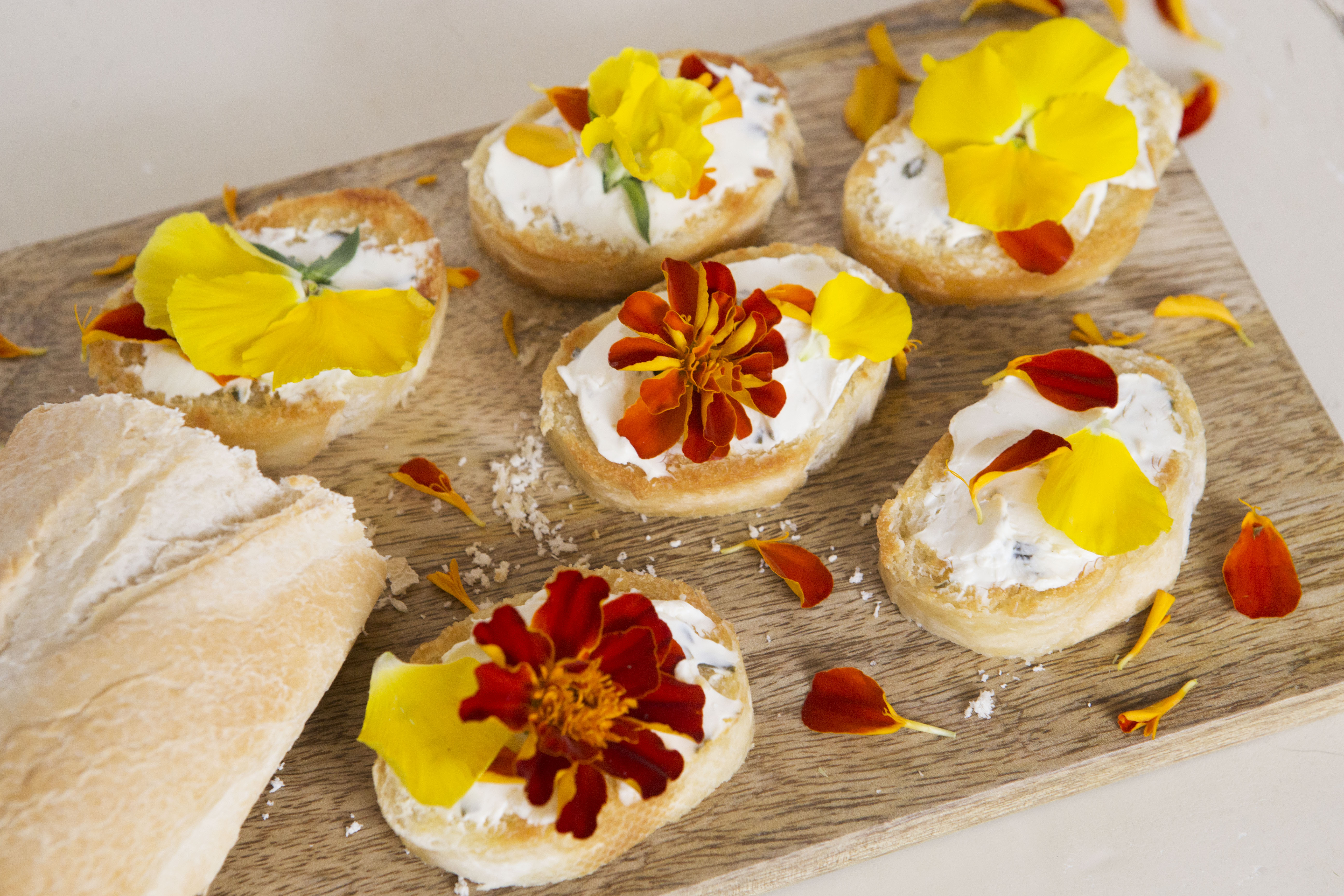 Cream Cheese and Chive Crostinis with Edible Flowers