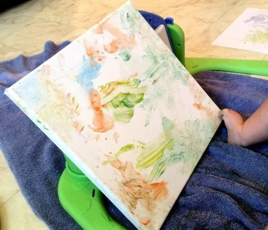 baby-painting-with-feet