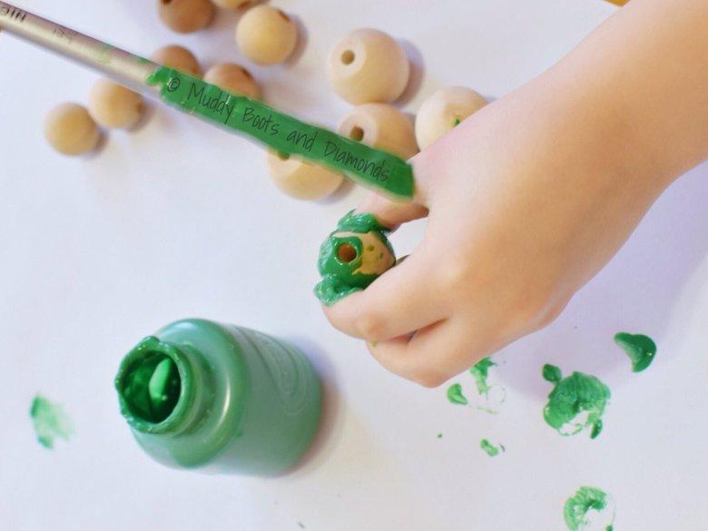 Easy Handmade Wood Bead Wreath Ornaments for kids via muddybootsanddiamonds.com