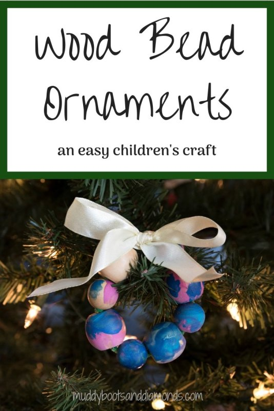 These Handmade Wood Bead Wreath Ornaments are an easy children's Christmas craft via muddybootsanddiamonds.com