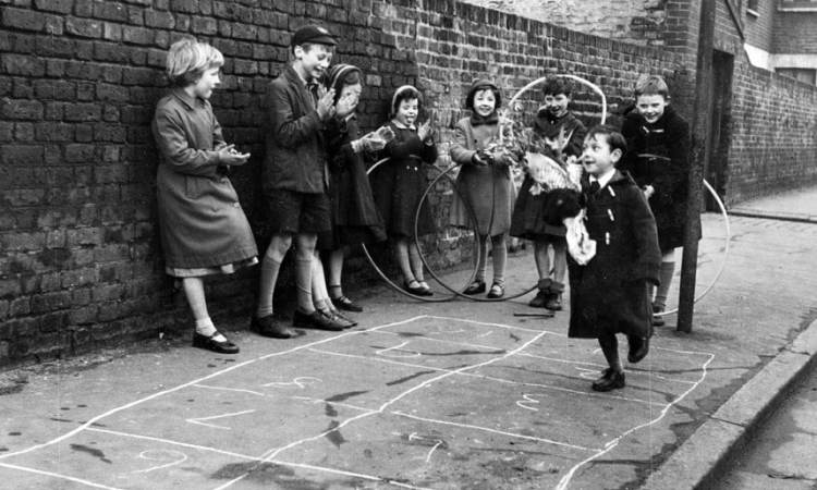 Old-fashioned photo of kids playing hopscotch