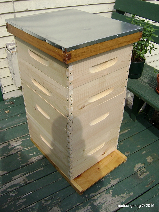 Two completed deeps over a bottom board with two medium supers and a top cover on top. In other words, a completed hive.