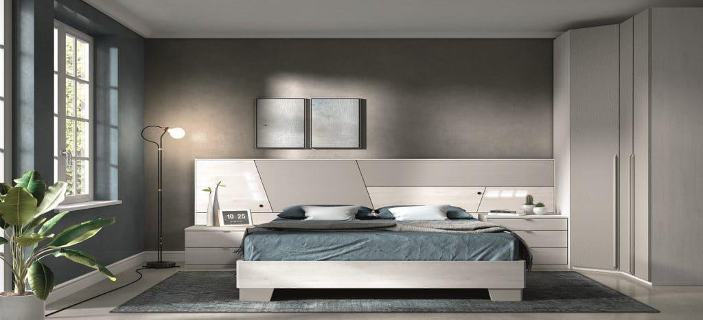 Habitación de matrimonio con cama y mesillas en blanco y gris