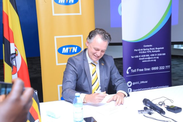 MTN Uganda and UCC officiate the telecommunication operator's license Renewal 3 MUGIBSON WRITES