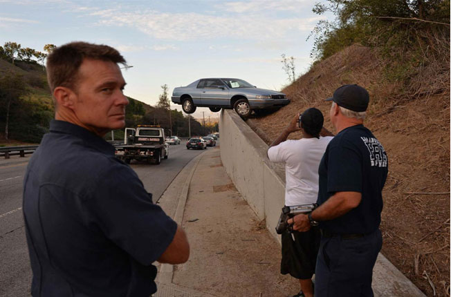 Car Dangles from Unlikely Perch after Skid in Los Angeles