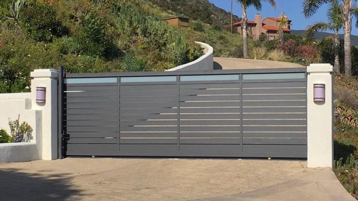 Aluminum and glass driveway gate