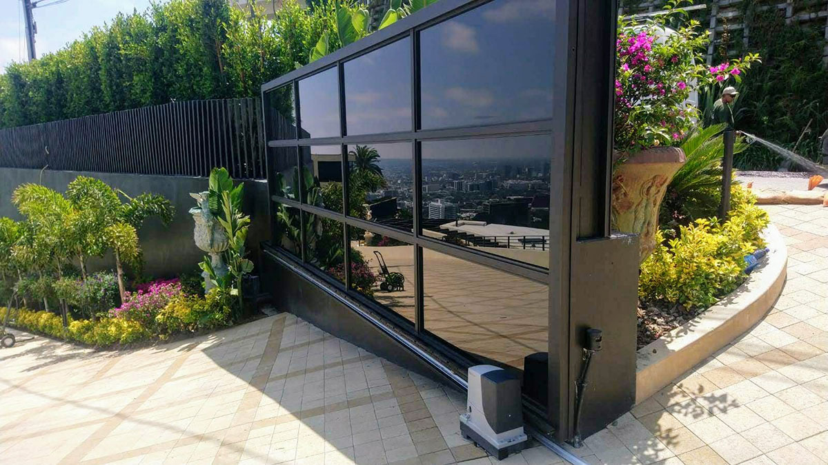 Black aluminum and black glass driveway gate