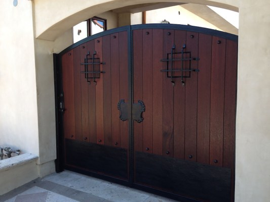 Dark wood entry gate with iron accents