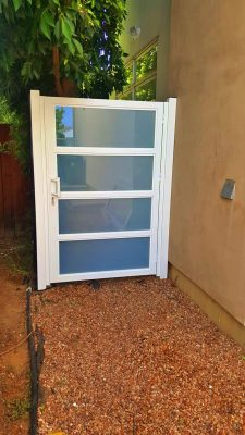 White aluminum and glass side entry gate