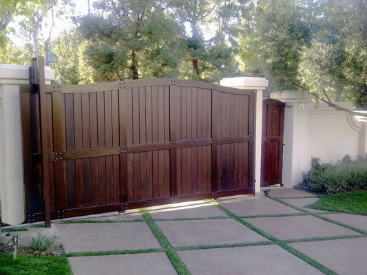 Dark wood driveway gate with side entry