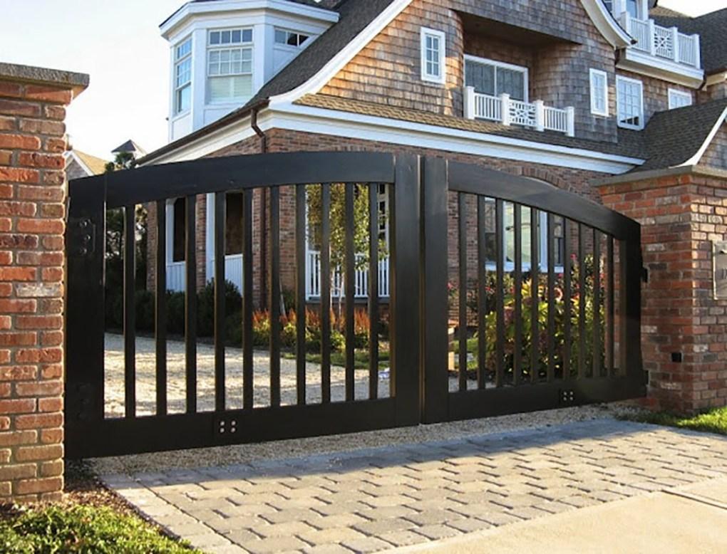 Vertical slated wood driveway gate