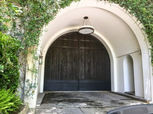 Dark wood gate in arched entry way