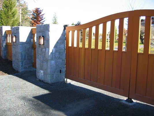 Tan wood driveway gate and fence