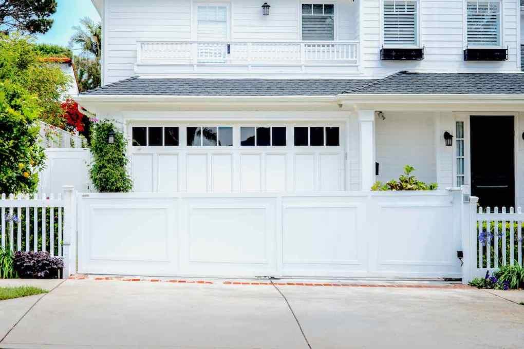 white aluminum sliding driveway gate
