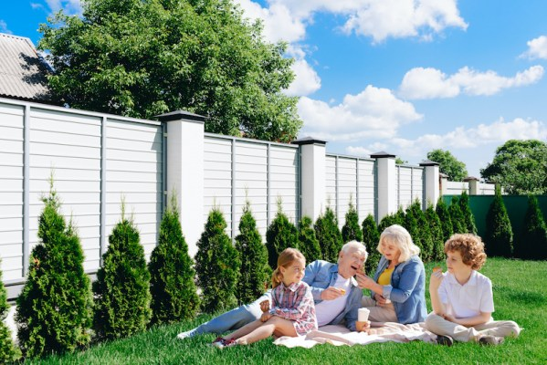 Family enjoying backyard privacy fence