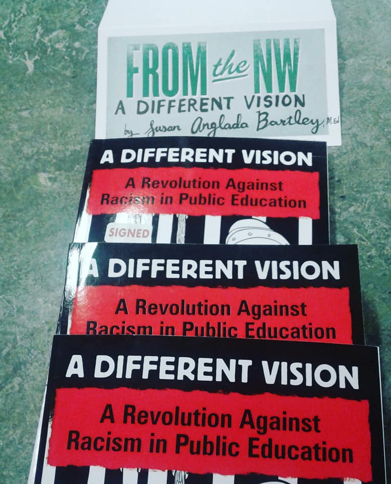 Two copies of the book _A Different Vision: A Revolution against Racism in Public Education