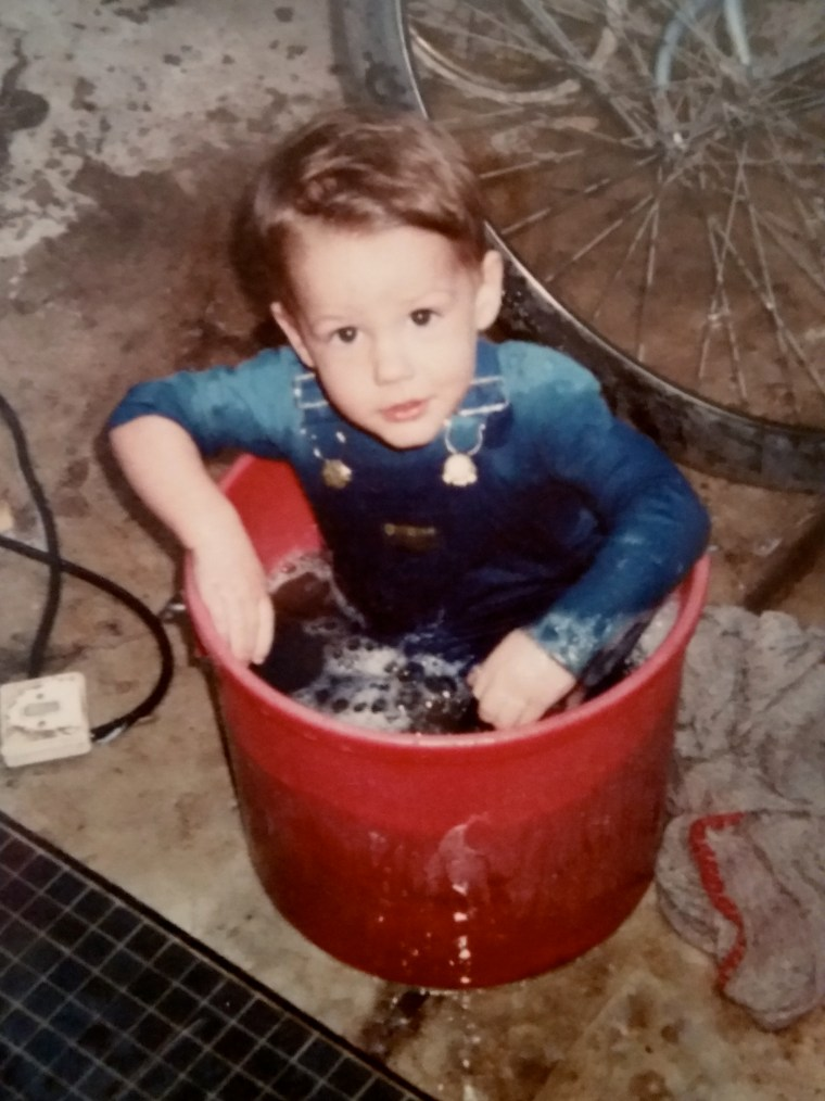 Alex about a year later. He managed to find the SAME bucket to play in. He was big enough this time to tip it if he needed to get out. I was cool enough to find my camera to mark the event.