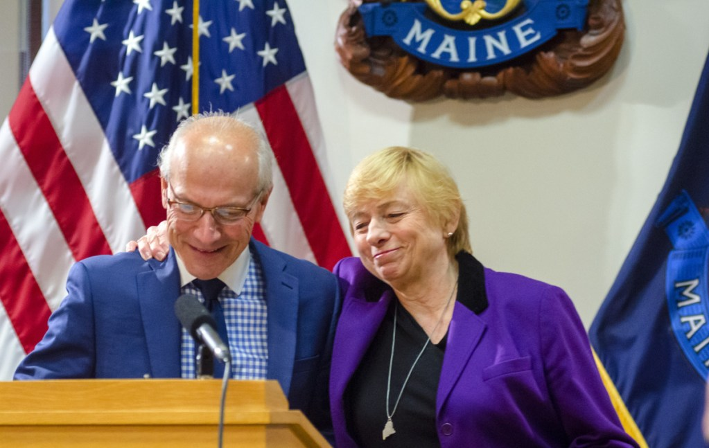 Maine Gov. Janet Mills and Gordon Smith, who is  the state's first director of opioid response. A summit on the issue is scheduled for Monday in Augusta.
