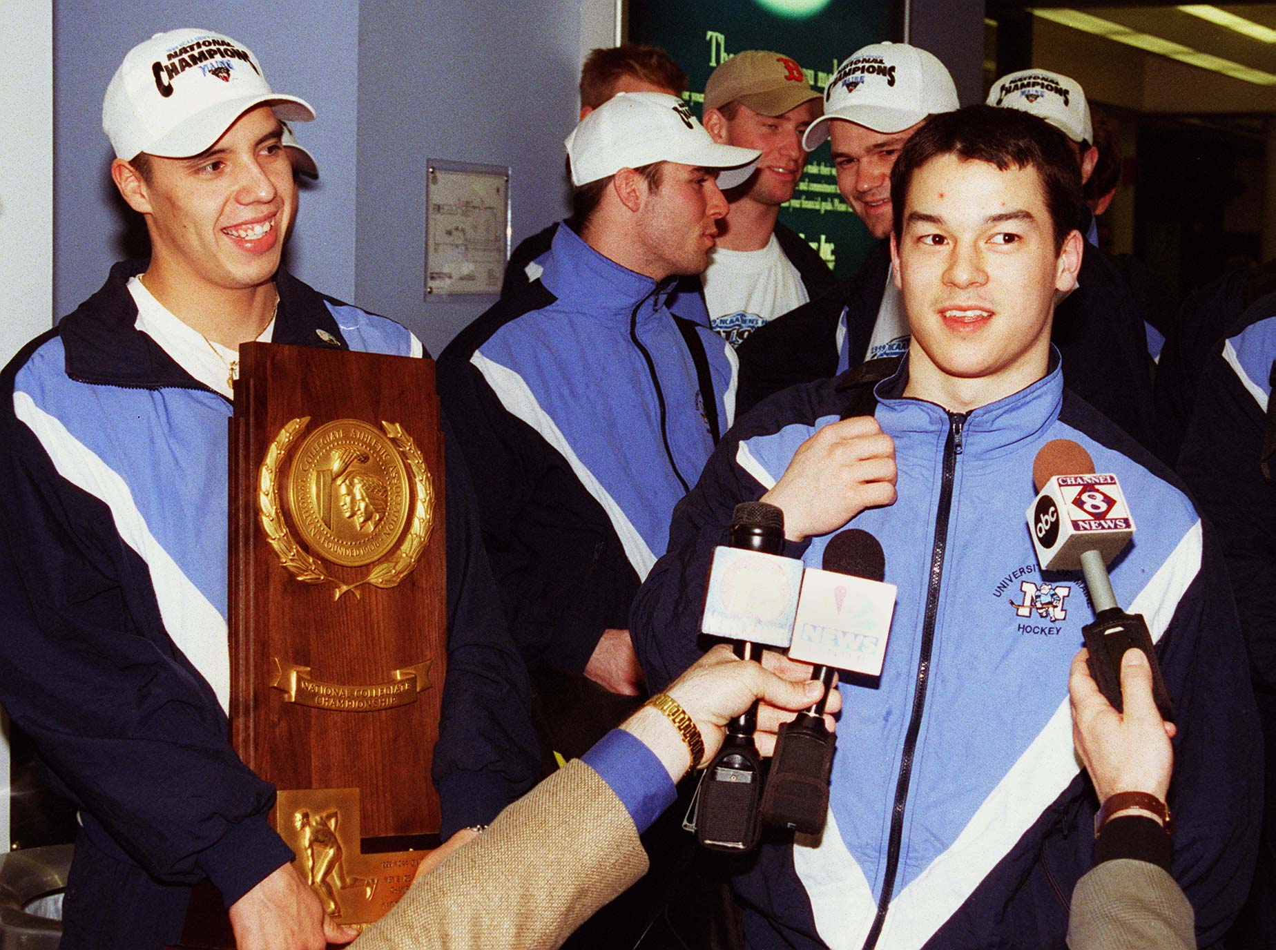 separation shoes c92ce e2b0b University of Maine goalie Alfie Michaud holds the national championship  trophy as forward Steve Kariya answers questions from the media in Portland  after ...