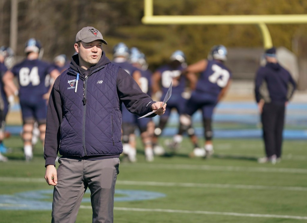 First-year head coach Nick Charlton is looking for young players to step up for the University of Maine football team. (Staff photo by Gregory Rec)