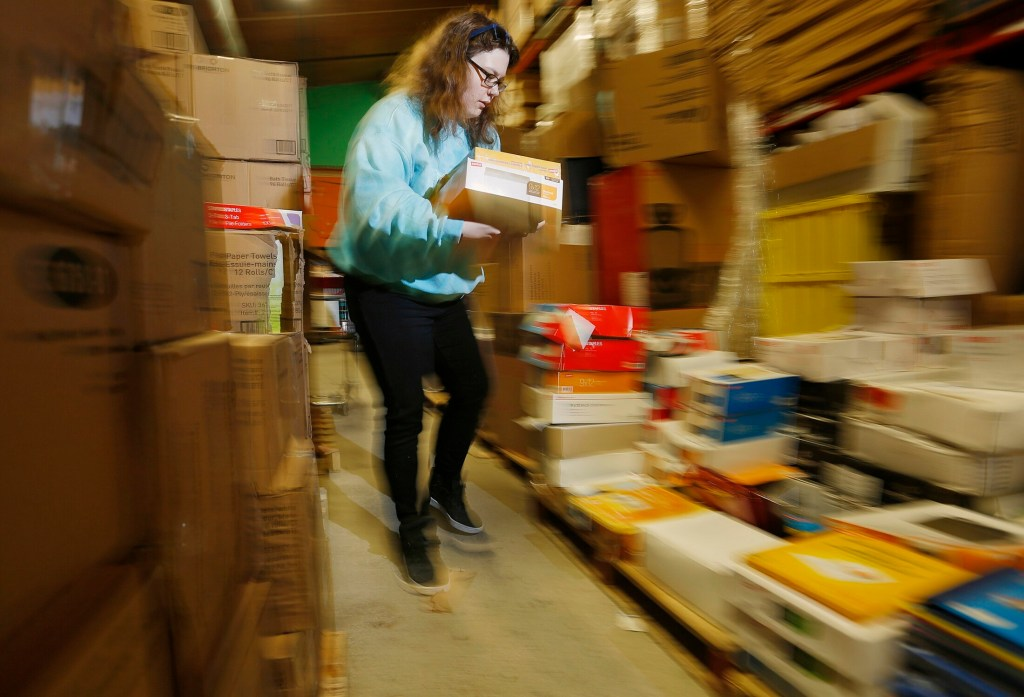 Volunteer Lizzy Wise upacks boxes of donations at Ruth's Resusable Resources.